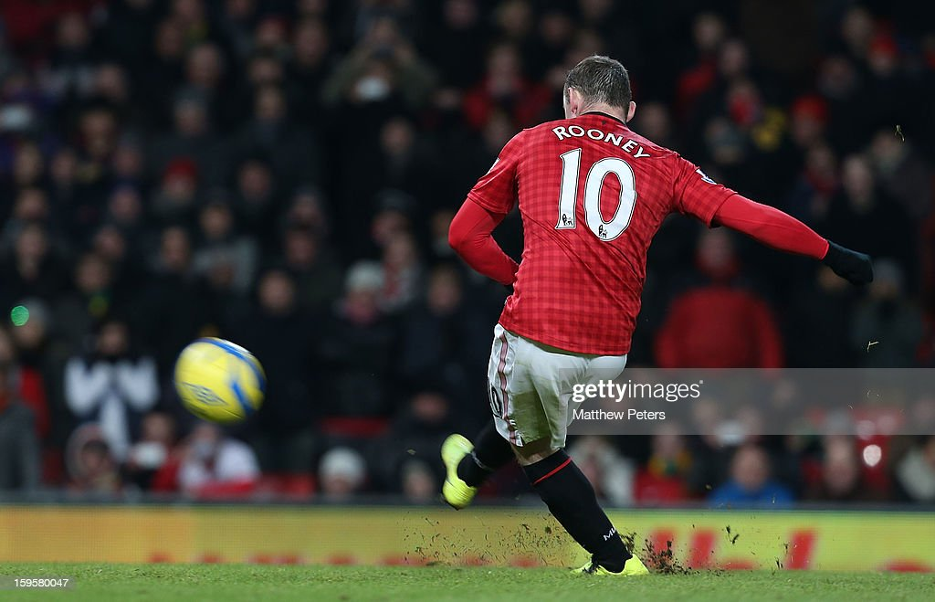 Wayne Rooney of Manchester United in action misses a penalty during the FA Cup Third Round Replay between Manchester United and West Ham United at Old Trafford on January 16, 2013 in Manchester, England.
