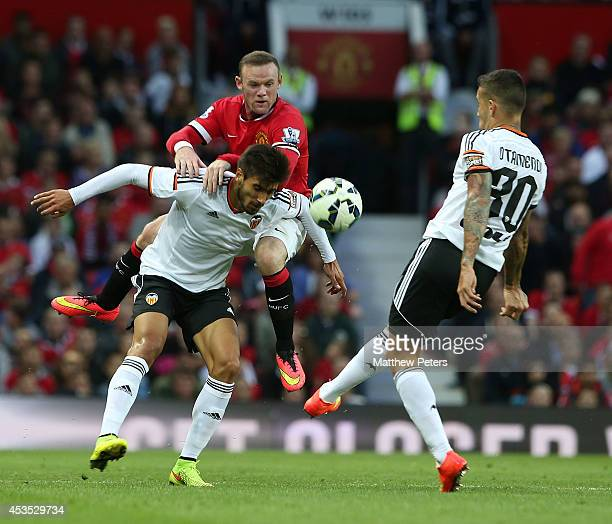 Wayne Rooney of Manchester United in action with Antonio Barragan of Valencia during the Pre Season Friendly match between Manchester United and...