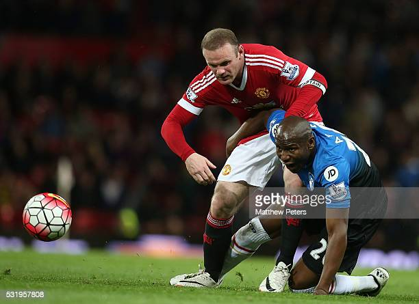 Wayne Rooney of Manchester United in action with Benik Afobe of AFC Bournemouth during the Barclays Premier League match between Manchester United...