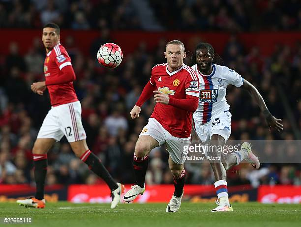 Wayne Rooney of Manchester United in action with Emmanuel Adebayor of Crystal Palace during the Barclays Premier League match between Manchester...