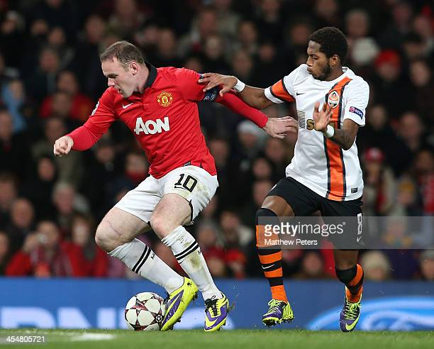 Wayne Rooney of Manchester United in action with Fred of Shakhtar Donetsk during the UEFA Champions League Group A match between Manchester United...