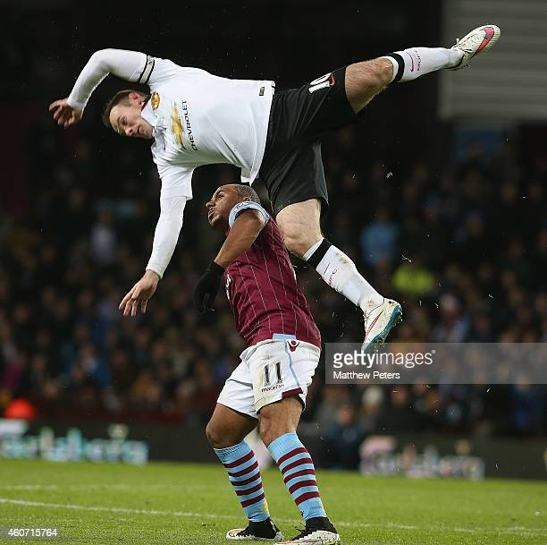 Wayne Rooney of Manchester United in action with Gabriel Agbonlahor of Aston Villa during the Barclays Premier League match between Aston Villa and...