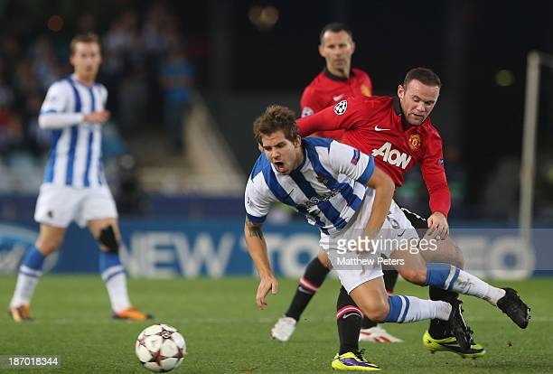 Wayne Rooney of Manchester United in action with Inigo Martinez of Real Sociedad during the UEFA Champions League Group A match between Real Sociedad...