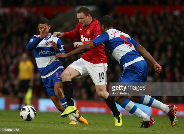 Wayne Rooney of Manchester United in action with Jobi McAnuff and Mikele Leigertwood of Reading during the Barclays Premier League match between...