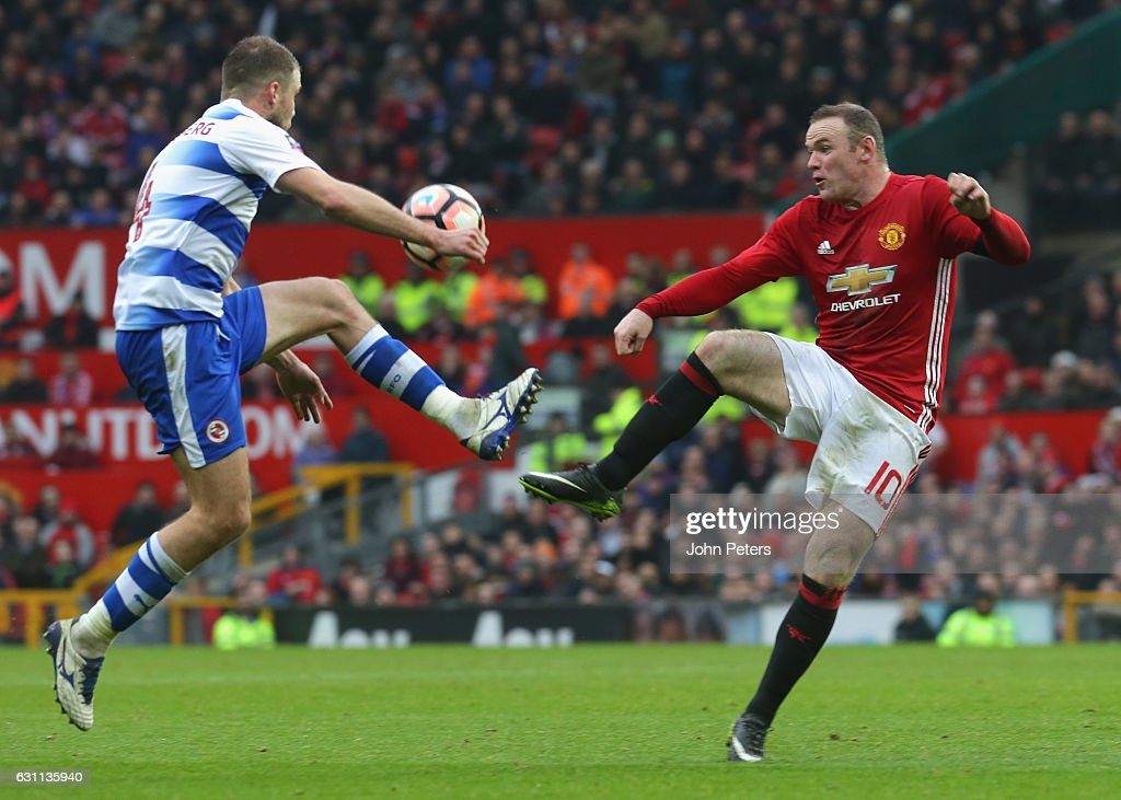 Wayne Rooney of Manchester United in action with Joey van den Berg of Reading during the Emirates FA Cup Third Round match between Manchester United and Reading at Old Trafford on January 7, 2017 in Manchester, England.