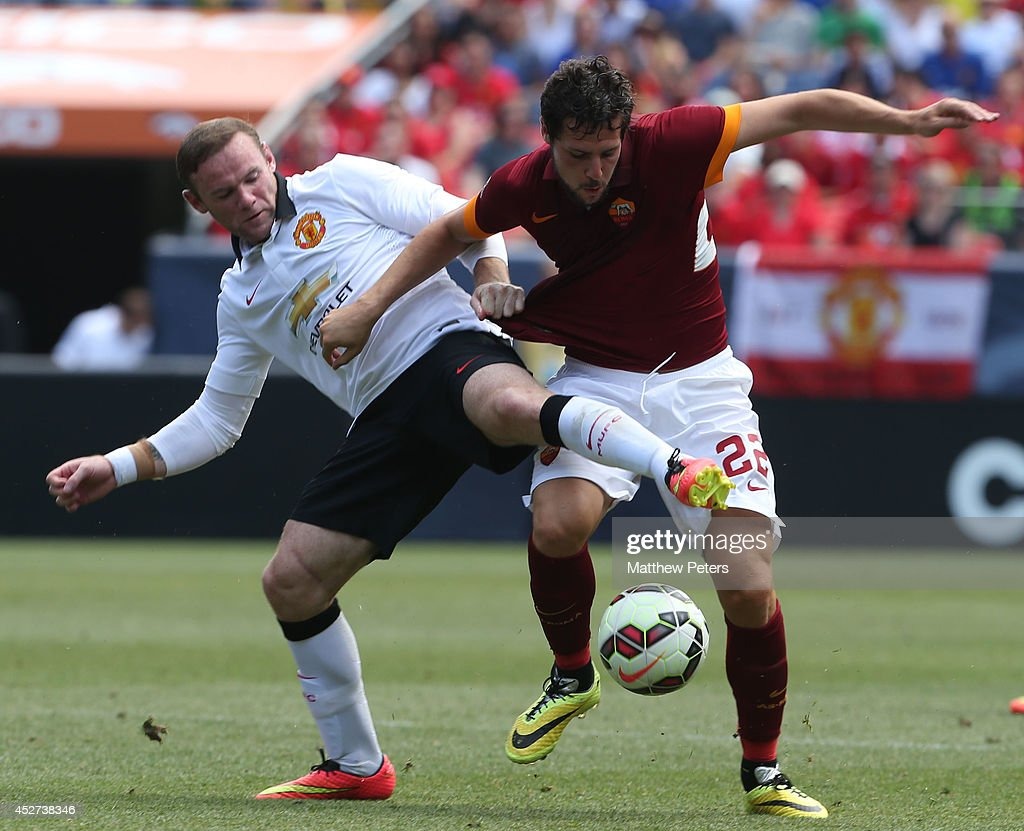 Wayne Rooney of Manchester United in action with Mattia Destro of AS Roma during the pre-season friendly match between Manchester United and AS Roma at Sports Authority Field at Mile High on July 26, 2014 in Denver, Colorado.