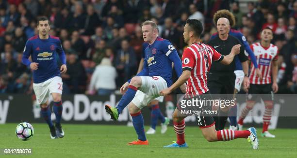 Wayne Rooney of Manchester United in action with Maya Yoshida of Southampton during the Premier League match between Southampton and Manchester...