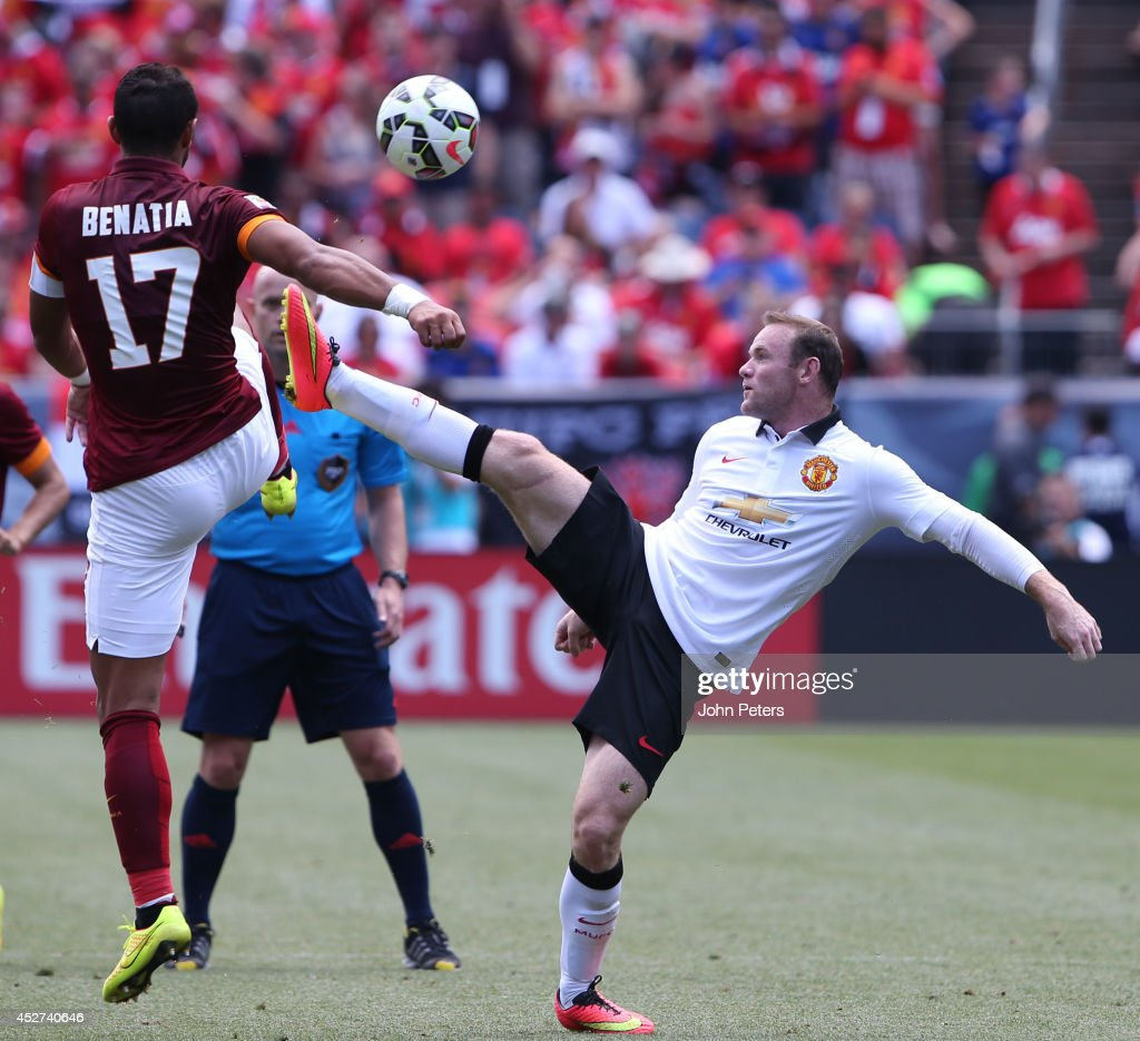 Wayne Rooney of Manchester United in action with Mehdi Benatia of AS Roma during the pre-season friendly match between Manchester United and AS Roma at Sports Authority Field at Mile High on July 26, 2014 in Denver, Colorado.
