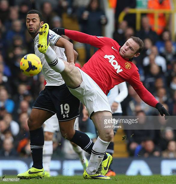 Wayne Rooney of Manchester United in action with Mousa Dembele of Tottenham Hotspur during the Barclays Premier League match between Manchester...