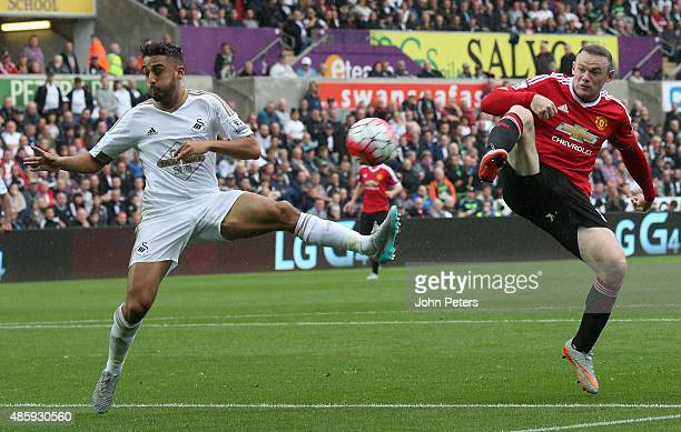 Wayne Rooney of Manchester United in action with Neil Taylor of Swansea City during the Barclays Premier League match between Swansea City and...