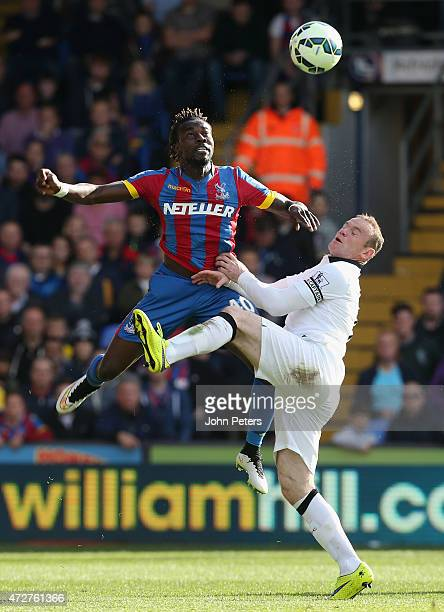 Wayne Rooney of Manchester United in action with Pape Souare of Crystal Palace during the Barclays Premier League match between Crystal Palace and...
