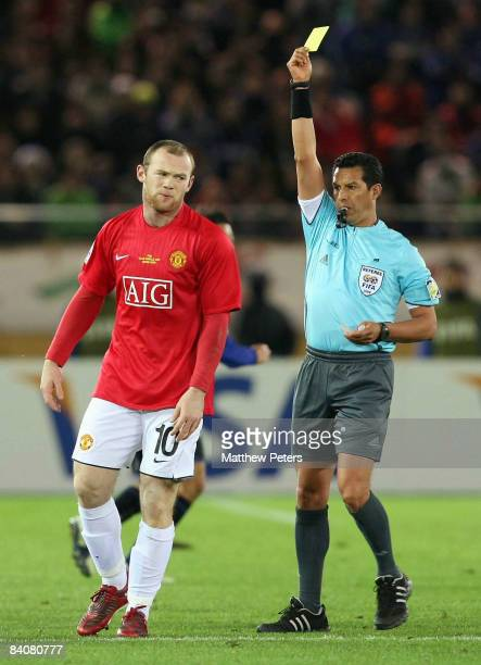 Wayne Rooney of Manchester United is booked for a clash with Michihiro Yasuda of Gamba Osaka during the FIFA World Club Cup Semi-Final match between...