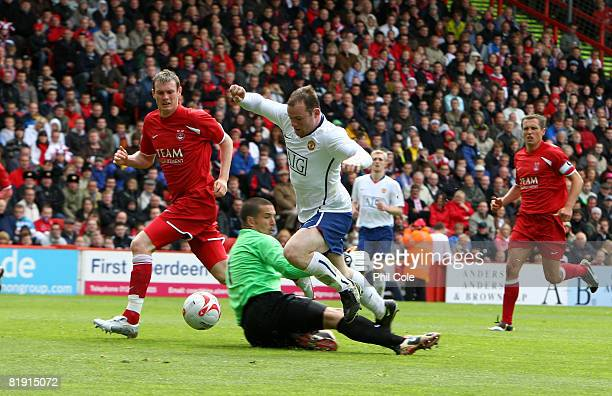 Wayne Rooney of Manchester United is brought down by Jamie Langfield of Aberdeen resulting in a penalty during the preseason friendly match between...