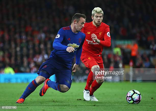Wayne Rooney of Manchester United is challenged by Alberto Moreno of Liverpool during the Premier League match between Liverpool and Manchester...