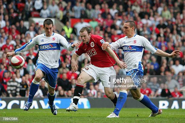 Wayne Rooney of Manchester United is challenged by Andrew Taylor and Emanuel Pogatetz of Middlesbrough during the Barclays Premiership match between...