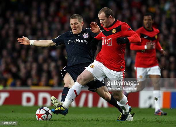Wayne Rooney of Manchester United is challenged by Bastian Schweinsteiger of Bayern Muenchen during the UEFA Champions League Quarter Final second...