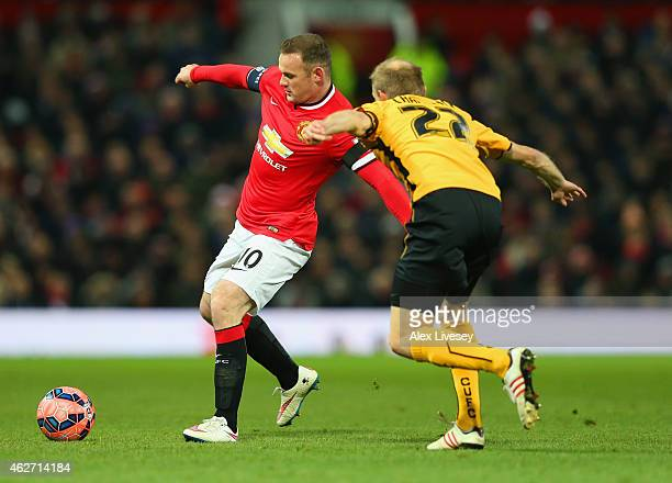 Wayne Rooney of Manchester United is closed down by Luke Chadwick of Cambridge United during the FA Cup Fourth round replay match between Manchester...