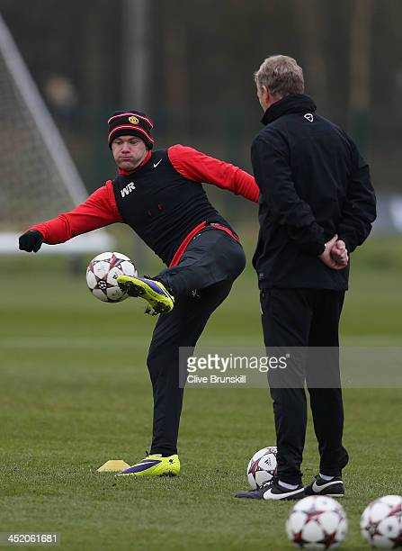 Wayne Rooney of Manchester United is closely watched by his manager David Moyes during a first team training session ahead of their UEFA Champions...