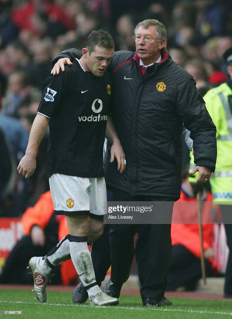 Wayne Rooney of Manchester United is congratulated by manager Alex Ferguson after his goal gave Manchester United victory over Liverpool during the Barclays Premiership match between Liverpool and Manchester United at Anfield on January 15, 2004 in Manchester, England.