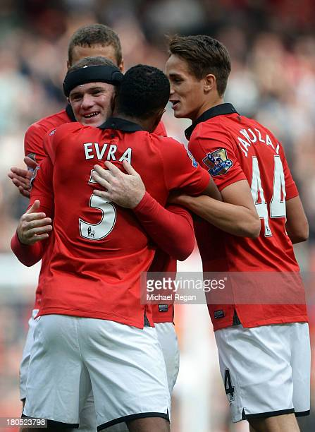 Wayne Rooney of Manchester United is congratulated by Patrice Evra as he scores their second goal during the Barclays Premier League match between...