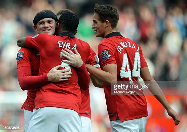 Wayne Rooney of Manchester United is congratulated by Patrice Evra and Adnan Januzaj as he scores their second goal during the Barclays Premier...