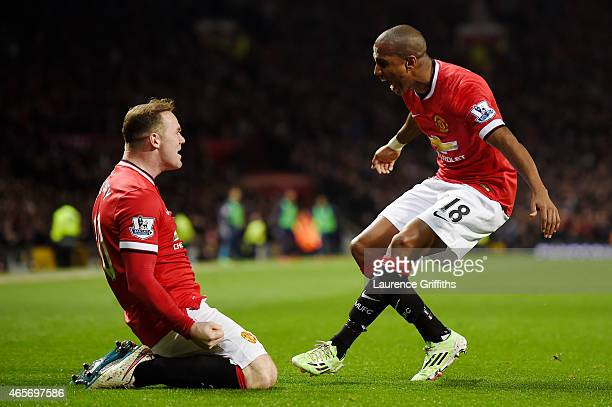 Wayne Rooney of Manchester United is congratulated by teammate Ashley Young of Manchester United after scoring a goal to level the scores at 11...