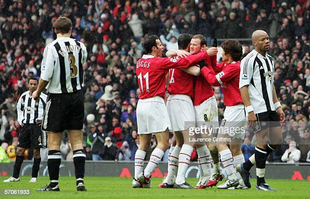 Wayne Rooney of Manchester United is congratulated on his second goal during the Barclays Premiership match between Manchester United and Newcastle...