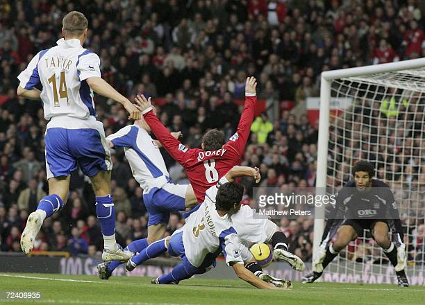 Wayne Rooney of Manchester United is fouled by Dejan Stefanovic of Portsmouth for which a penalty was awarded during the Barclays Premiership match...