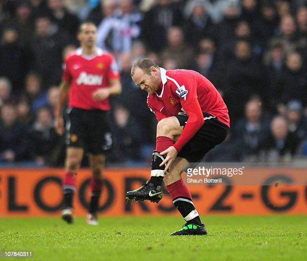Wayne Rooney of Manchester United is injured during the Barclays Premier League match between West Bromwich Albion and Manchester United at The...