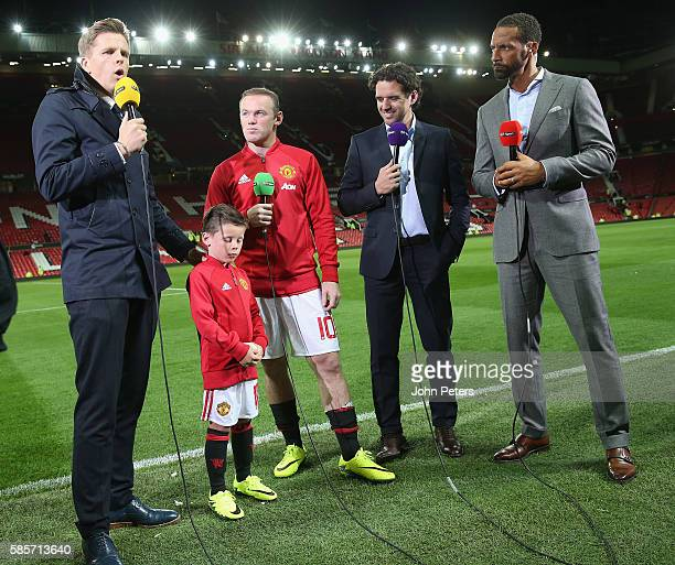 Wayne Rooney of Manchester United is interviewed by Jake Humphrey of BT Sport after the Wayne Rooney Testimonial match between Manchester United and...