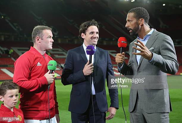 Wayne Rooney of Manchester United is interviewed by Rio Ferdinand and Owen Hargreaves of BT Sport after the Wayne Rooney Testimonial match between...