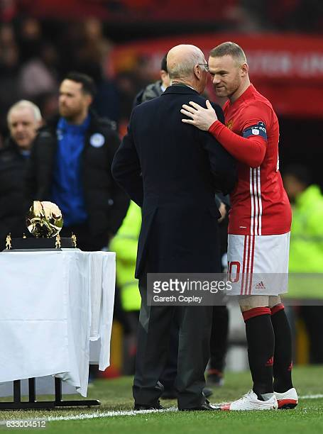 Wayne Rooney of Manchester United is presented with an award for becoming the club's top goal scorer of all time from Sir Bobby Charlton prior to the...