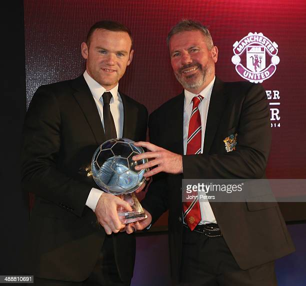 Wayne Rooney of Manchester United is presented with ths Goal of the Season award for his strike against West Ham United by Brian McClair at the...