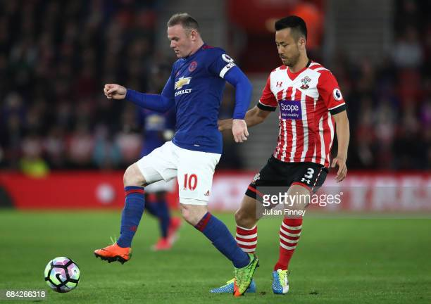Wayne Rooney of Manchester United is put under pressure from Maya Yoshida of Southampton during the Premier League match between Southampton and...