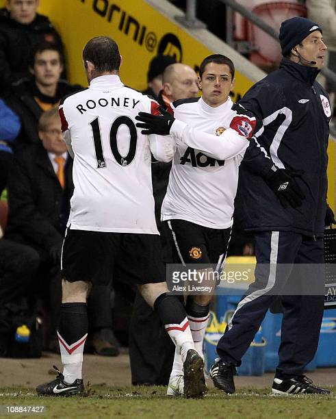 Wayne Rooney of Manchester United is substituted for team mate Chicharito during the Barclays Premier League match between Blackpool and Manchester...