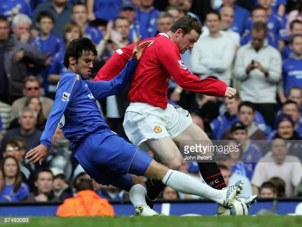 Wayne Rooney of Manchester United is tackled by Paulo Ferreira of Chelsea leading to Rooney being stretchered off injured during the Barclays...