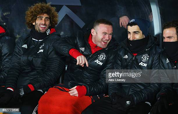 Wayne Rooney of Manchester United jokes on the bench with team mates Marouane Fellaini , Henrikh Mkhitaryan and Juan Mata the EFL Cup Semi-Final...