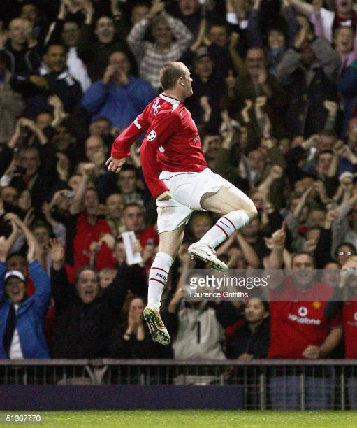 Wayne Rooney of Manchester United jumps for joy as he scores his third goal during the UEFA Champions League Group D match between Manchester United...