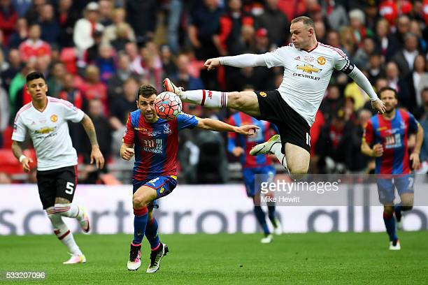 Wayne Rooney of Manchester United jumps for the ball ahead of James McArthur of Crystal Palace during The Emirates FA Cup Final match between...