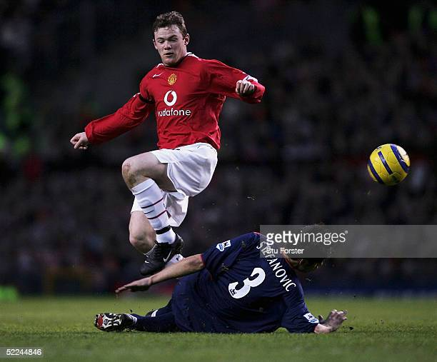 Wayne Rooney of Manchester United jumps the challenge of Dejan Stefanovic during the Barclays Premiership match between Manchester United and...