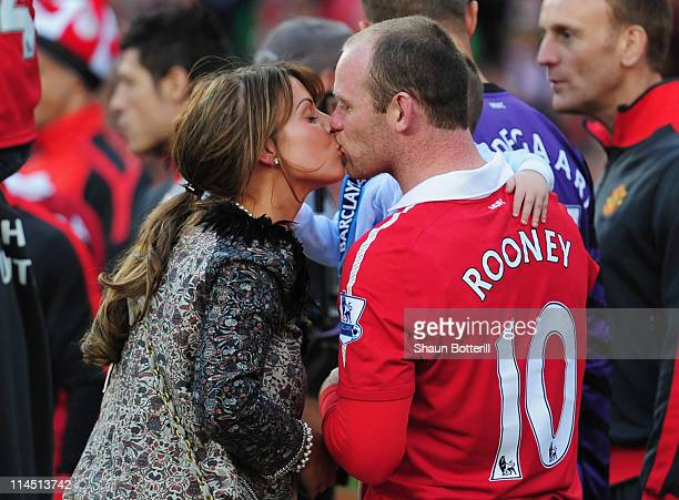 Wayne Rooney of Manchester United kisses wife Coleen after the Barclays Premier League match between Manchester United and Blackpool at Old Trafford...