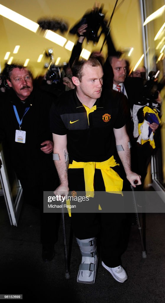 Wayne Rooney of Manchester United leaves on crutches after the UEFA Champions League quarter final first leg match between Bayern Muenchen and Manchester United at the Allianz Arena on March 30, 2010 in Munich, Germany.