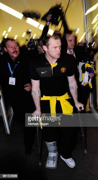 Wayne Rooney of Manchester United leaves on crutches after the UEFA Champions League quarter final first leg match between Bayern Muenchen and...