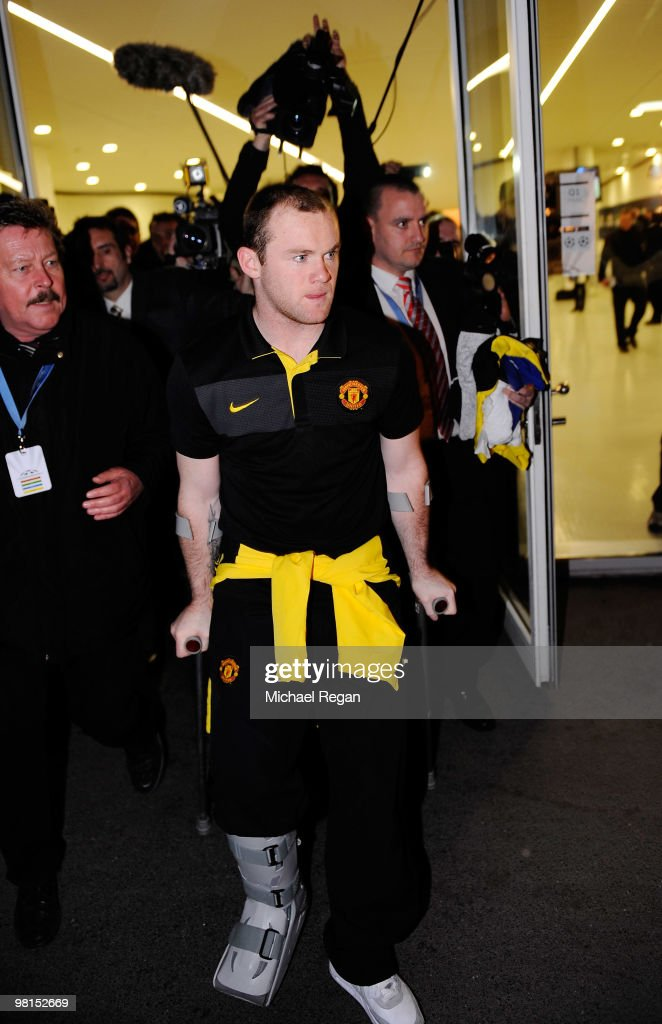 Wayne Rooney of Manchester United leaves on crutches during the UEFA Champions League quarter final first leg match between Bayern Muenchen and Manchester United at the Allianz Arena on March 30, 2010 in Munich, Germany.