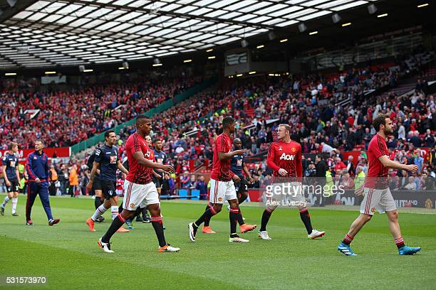 Wayne Rooney of Manchester United leaves the field with team mates before the match was abandoned prior to the Barclays Premier League match between...