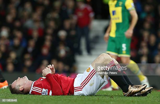 Wayne Rooney of Manchester United lies injured during the Barclays Premier League match between Manchester United and Norwich City at Old Trafford on...