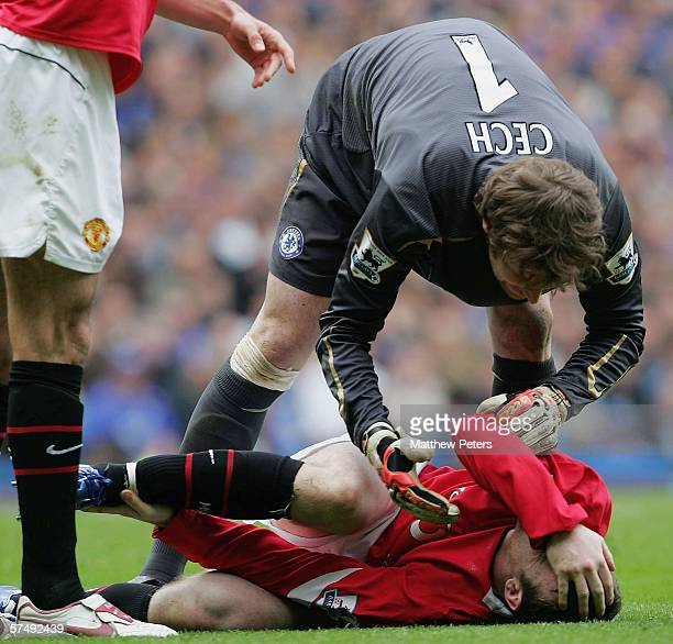 Wayne Rooney of Manchester United lies injured during the Barclays Premiership match between Chelsea and Manchester United at Stamford Bridge on...