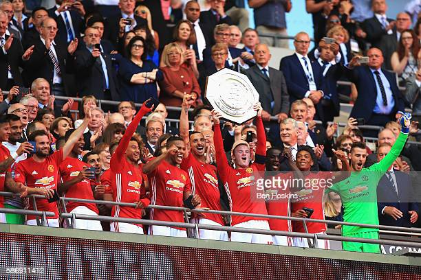 Wayne Rooney of Manchester United lifts the Community Shield after the final whistle during The FA Community Shield match between Leicester City and...