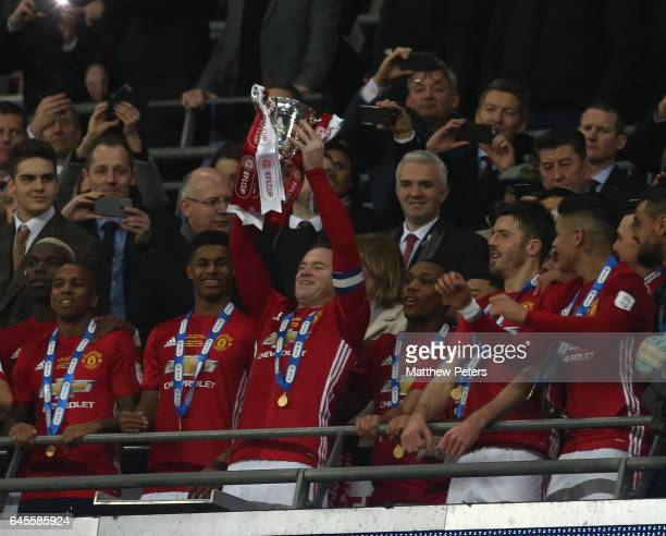 Wayne Rooney of Manchester United lifts the EFL Cup after the EFL Cup Final match between Manchester United and Southampton at Wembley Stadium on...