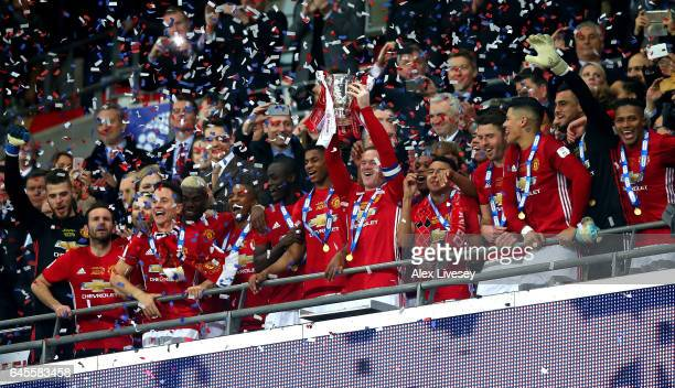 Wayne Rooney of Manchester United lifts the EFL trophy with teammates after the EFL Cup Final match between Manchester United and Southampton at...